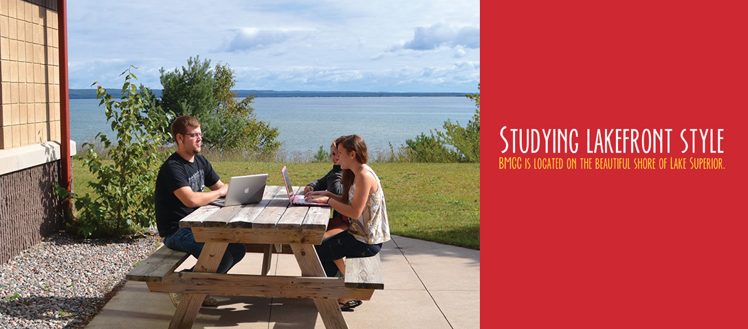 Studying Lakefront Style picnic table overlooking the lake during warm summer day