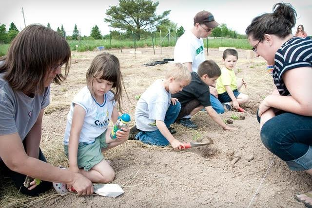 Children Planting at the Waishkey Bay Farm